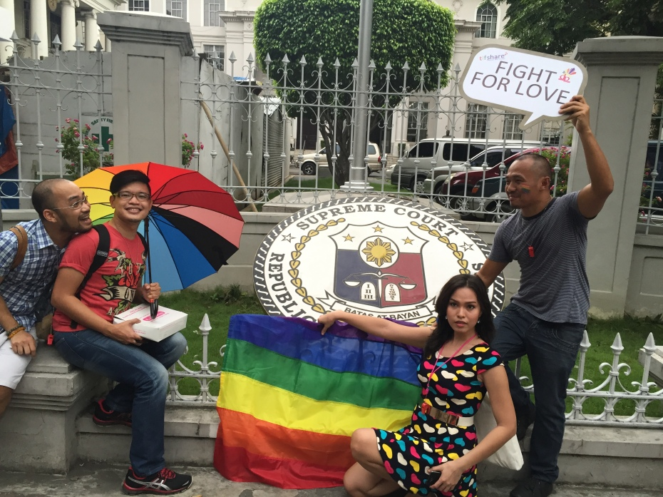 A group of participants of the Metro Manila Pride March on June 27 poses in front of the Supreme Court with rainbow flags, urging the court to follow suit the SCOTUS ruling that legalized gay marriage in the United States. Photo by Speqtrum