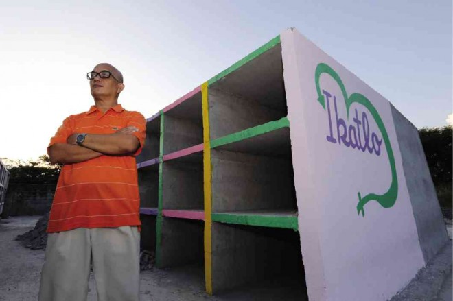 Pedro Arnel Laparan poses with the colorful tombs for departed lesbians, gays, bisexuals and transgenders at the Salinas Garden of Memories in Rosario, Cavite. Photo from Raffy Lerma, Philippine Daily Inquirer