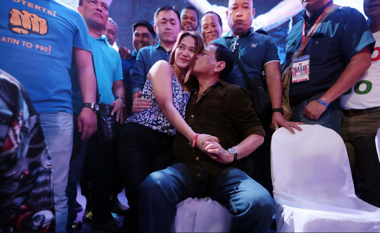 """Davao city Mayor Rodrigo Duterte flaunts with women during his """"Mad for Change"""" event in Taguig city. Photo from Grig Montegrande, Philippine Daily Inquirer."""
